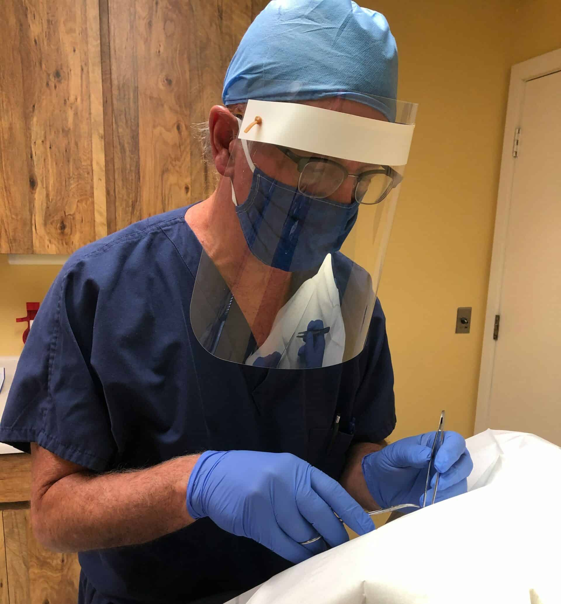 Sarasota doctor wearing Suncoast Science Center/Faulhaber Fab Lab face mask and face shield